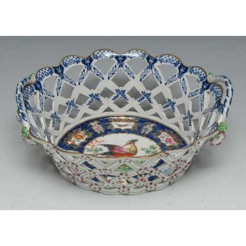 29 - A Worcester type basket, decorated with fanciful bird, on a blue scale ground, with alternating fans...