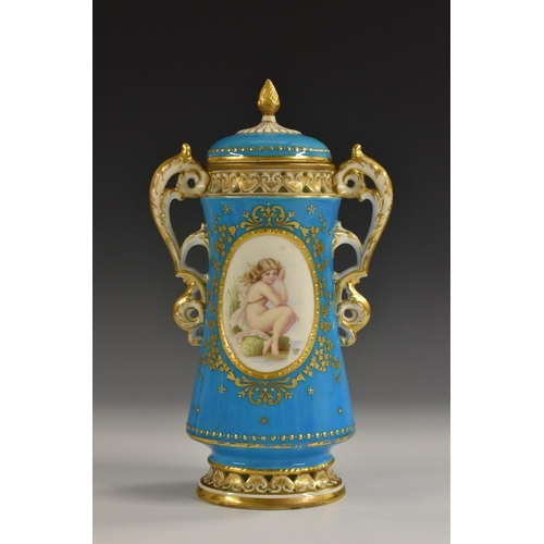 35 - A Mintons waisted cylindrical vase and cover, decorated with an jewelled oval cartouche with water n...