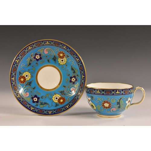 36 - A Minton tea cup and saucer, painted with a design by Christopher dresser, with floral roundels and ...