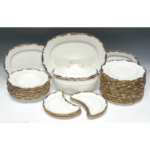 42 - A Cauldron dinner service, comprising seventeen plates, eight bowls, six crescent plates, two servin...