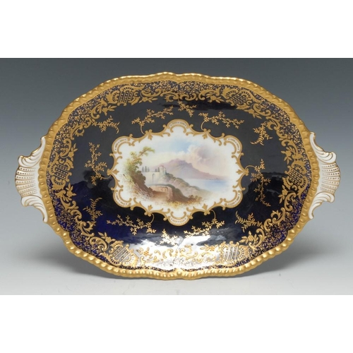 45 - A Coalport Named View shaped oval two handled dish, painted by A. Perry, signed, with San Remo, with...