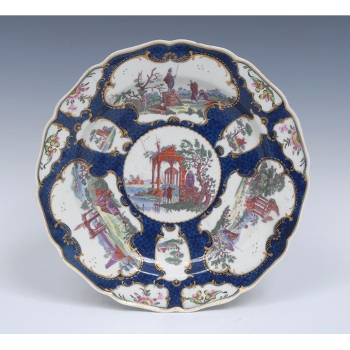 66 - A Worcester shaped circular dessert plate, in the Meissen manner, printed in puce and overpainted in...