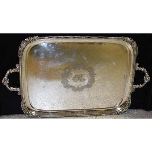 10 - A large Victorian E.P.N.S two-handled rounded rectangular serving tray, gadrooned border with scroll...
