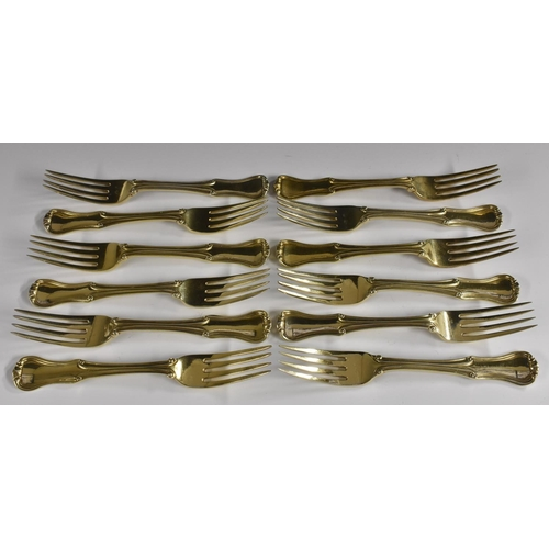 31 - A set of twelve William IV silver-gilt King's pattern variant dessert forks, William Chawner, London...