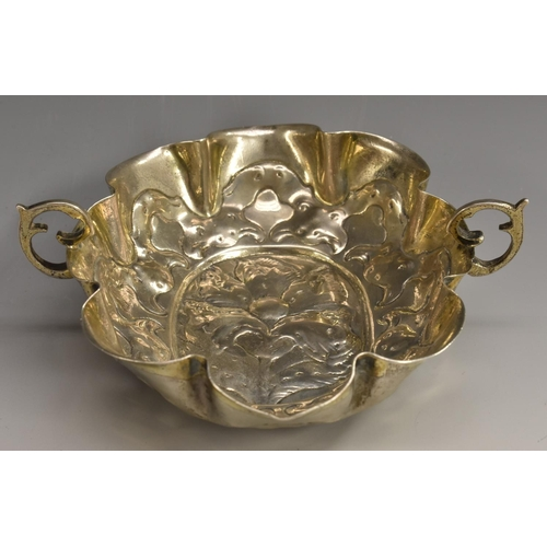 40 - A 17th century German silver shaped oval wine taster or brandy bowl, chased with a stylised flower a...