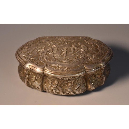 53 - A Continental silver shaped serpentine snuff box, chased with putti frolicking in an Arcadian landsc...