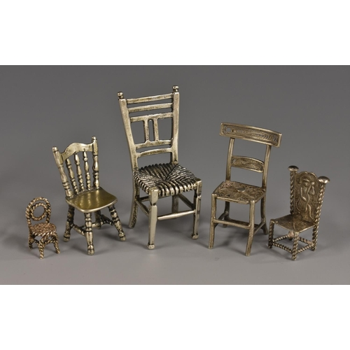 57 - A Continental silver toy miniature model, of a Victorian kitchen chair, 3.5cm high, import marks for...