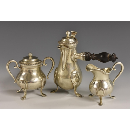 62 - A French silver toy miniature coffee service, comprising side-handled coffee pot, milk jug and sucri...
