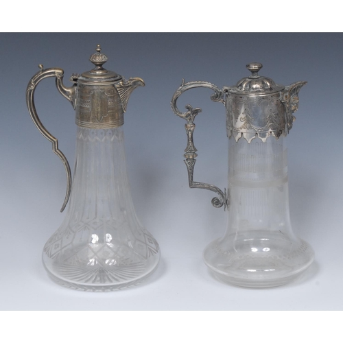 8 - A  Victorian clear glass and  E.P.N.S mounted claret jug, 28cm high, c.1890;  another, similar  (2)...