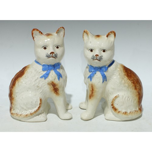 23 - A pair of Staffordshire pottery cats, approx. 21cm high...