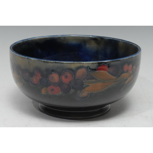 25 - A Moorcroft Pomegranate pattern bowl tube lined with sliced and whole fruit, 16cm diam, impressed ma...