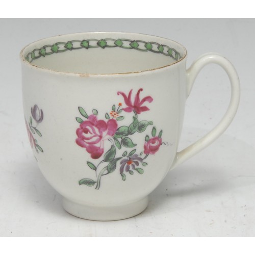 27 - A Pennington Liverpool coffee cup, decorated in polychrome with scattered flowers, loop handle, c.17...