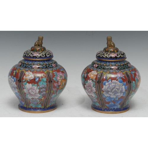45 - A pair of Chinese cloisonne baluster jars and covers, gilt temple lion finials, decorated in polychr...