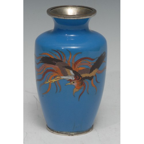 48 - A Chinese cloisonne enamel ovoid vase, decorated in polychrome with a phoenix, on a pale blue ground...
