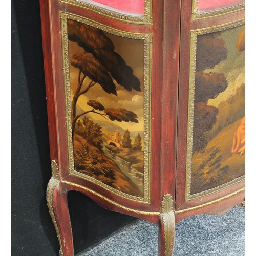1 - A Louis XV style gilt metal mounted mahogany shaped serpentine vitrine, pierced gallery above a thre...