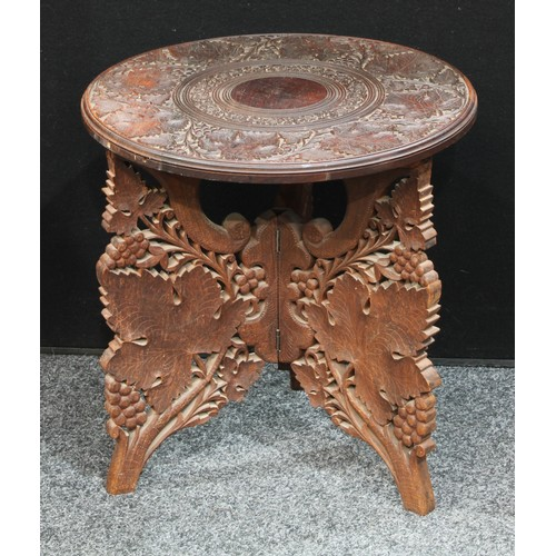 5 - A small circular wine table, carved with fruiting vine, tripod base,45cm diameter, 46cm high...