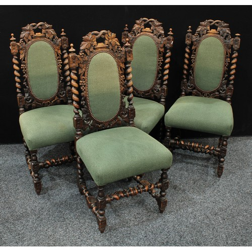 8 - A set of four Jacobean style oak dining side chairs (4)...