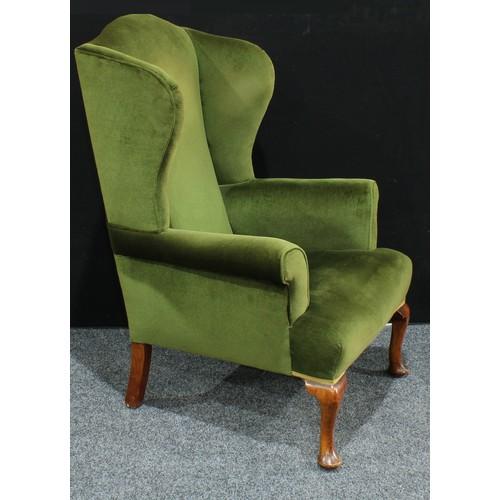 14 - A George II style wing back arm chair, scroll arms, cabriole legs, pad feet, 119cm high....