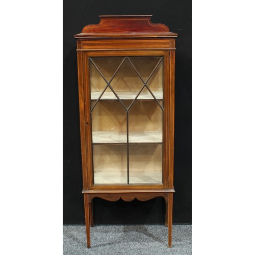 16 - An Edwardian mahogany display cabinet, shaped half gallery above a rectangular top, astro glazed doo...