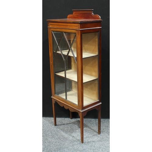16 - An Edwardian mahogany display cabinet, shaped half gallery above a rectangular top, astro glazed doo...