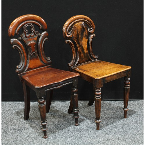 17 - A William IV mahogany hall chair, carverd back, serpentine seat, turned legs, 85cm high; another Wil...