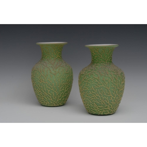 15 - A pair of Victorian green textured satin glass ovoid vases, applied with ferns, 20cm high, c.1880...