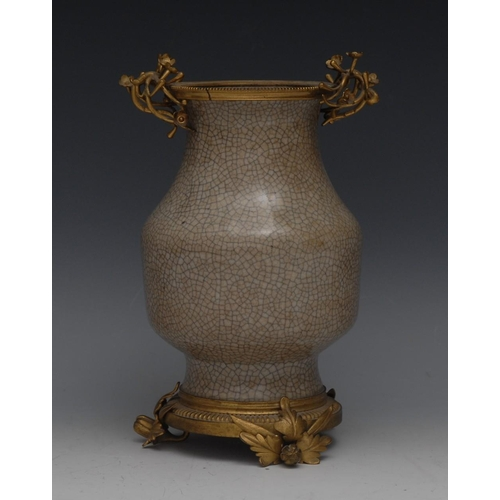 25 - A gilt metal mounted Chinese crackle glazed pale grey celadon ovoid vase, the mounts as flowering le...