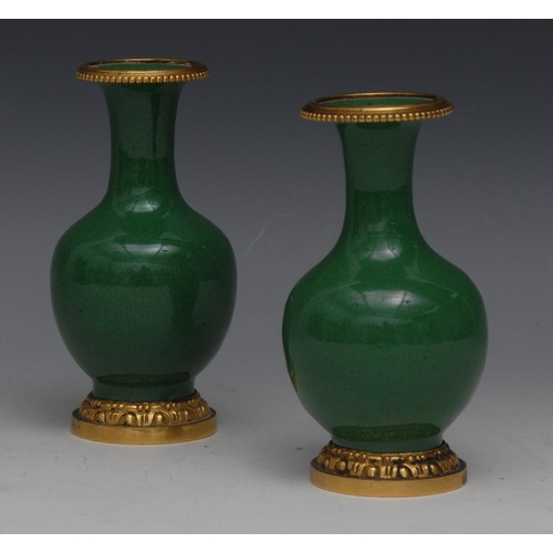 26 - A pair of small gilt metal mounted Chinese monochrome ovoid vases, green crackle glaze, 11.5cm high,...