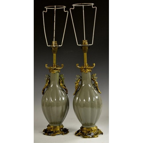 27 - A pair of Chinese green celadon fluted ovoid vases, ormolu mounted as table lamps, archaic scroll ha...