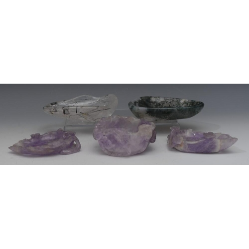 32 - A Chinese amethyst crystal brush washer, carved with blossom, flowerheads, bird of paradise and furt...