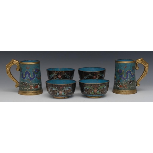 36 - A pair of Chinese cloisonne enamel spreading cylindrical mugs, decorated in polychrome with wavy sea...