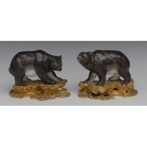 4 - A pair of ormolu mounted porcelain models, of bears, in the manner of  Kändler's Meissen, modelled s...