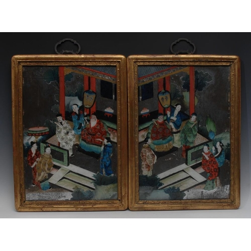 40 - Chinese School, a pair of reverse paintings on glass, depicting figures of the court, 48cm x 33cm...