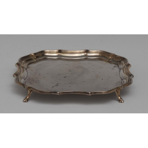 48 - A George V silver shaped square waiter, of 18th century design, fluted piecrust border, plain field,...