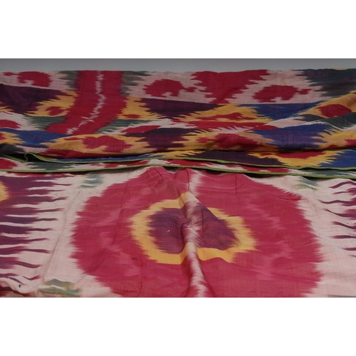 57 - A 19th century satin throw, brightly decorated in merging tones, 227cm x 138cm; another, similar (2)...