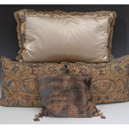 59 - A pair of 'early 18th century' cushions, worked in coloured threads with putti within oval reserves ...
