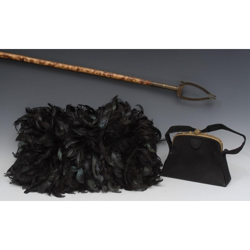 60 - A Victorian ostrich feather muff, 55cm wide, c.1880; a late 19th century handbag; a Victorian bamboo...