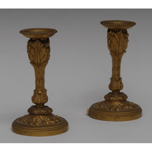 76 - A pair of 19th century French ormolu boudoir mantel candlesticks, beaded sconces, acanthus cast colu...