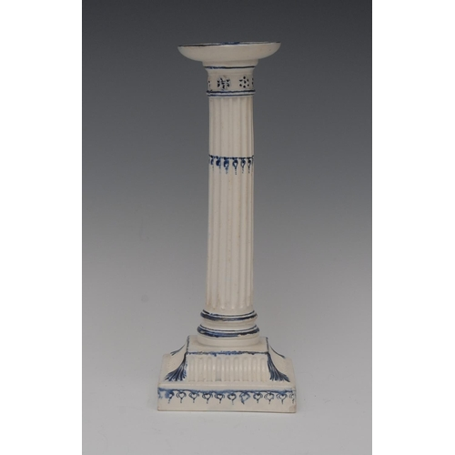 17 - A Wedgwood Pearlware candlestick, dished sconce, fluted column, spreading square fluted  base, leave...