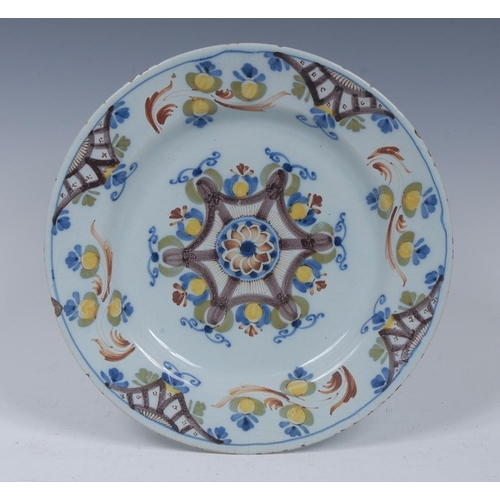 18 - An 18th century Delft plate, decorated in manganese, blue and  green, 22.5cm diam, c.1760...