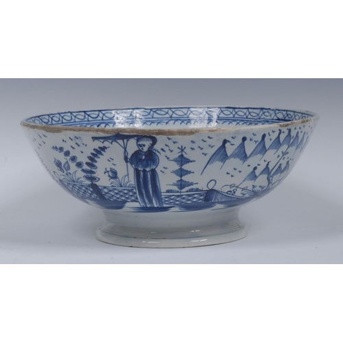 2 - A 19th century Pearlware bowl, the exterior decorated in blue with stylised pagoda, fence and figure...