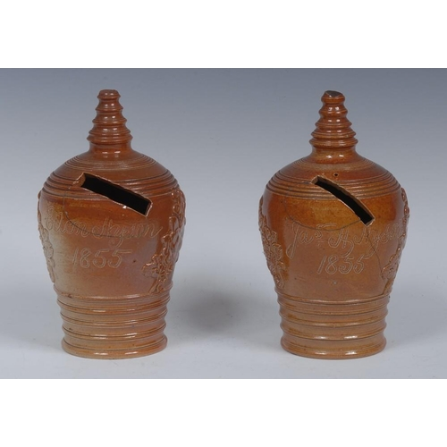 25 - A Brampton brown salt glazed stoneware beehive money box, applied with Cupids at work, inscribed Jas...