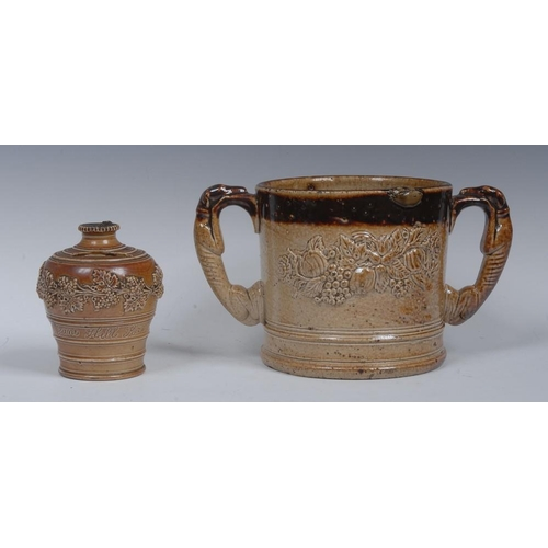 26 - A Brampton brown salt glazed stoneware two-handled loving cup, applied with fruit, flowers and folia...
