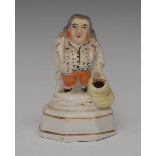30 - A Staffordshire Jolly Toper pen holder, of a rotund gentleman, wearing a gilt lined jacket, black sp...