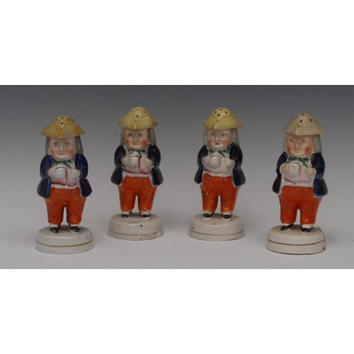 31 - A Staffordshire Jolly Toper pepper pot, he stands holding a mug of foaming ale, wearing a yellow tri...