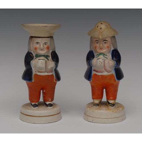 33 - A pair Staffordshire Jolly Toper pepper and salt pots, they stands holding a mugs of foaming ale, th...