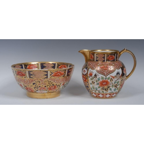 37 - A Spode wash jug and bowl, decorated in the Imari palette, with stylised flowers and scrolls, the ju...