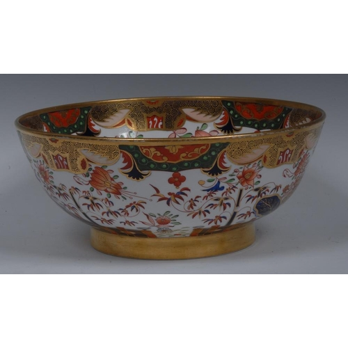 38 - A Spode wash bowl, decorated in the Imari palette with stylised bamboo, fence and foliage, the sides...
