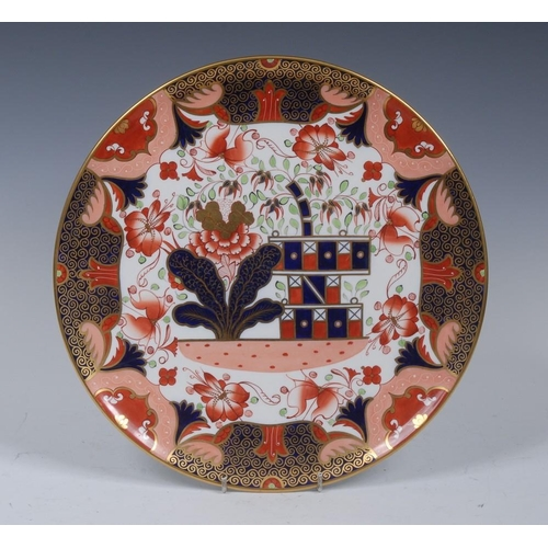 39 - A Spode circular charger, decorated with stylised leaves and foliage, in the Imari palette,  30.5cm ...