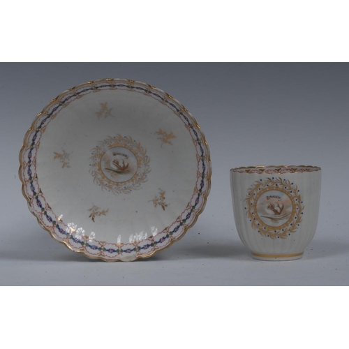 48 - A Caughley fluted coffee cup and saucer, decorated with love birds, inscribed L Amitie, within gilt ...